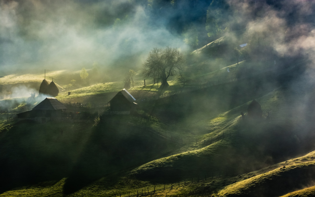 2700x1688 pix. Wallpaper fairy tale, mist, sunrise, village, trees, grass, house, fence, hill, Romania, nature, landscape