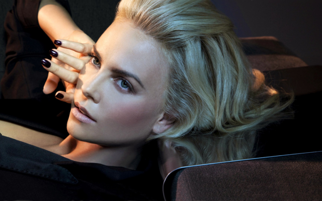 1920x1080 pix. Wallpaper blonde, face, black clothing, painted nails, Charlize Theron