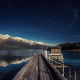 night, lake, pier, reflection, mountains, stars wallpaper