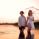 kids, boy, girl, water, lake, umberlla, sunset wallpaper