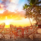 beach, sand, palms, bungalow, chair, table, sunset, tropics wallpaper