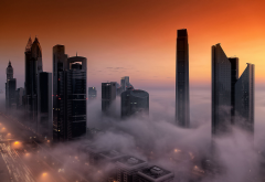 dubai, city, skyscrapers, fog, clouds wallpaper