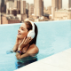Doutzen Kroes, women, swimming pool, smiling, headphones wallpaper