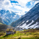 geiranger, stryn, norway, sun rays, cottage, mountains, nature, snowy peak, grass, clouds wallpaper