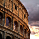colosseum, rome, italy, dark clouds, city, sunset wallpaper