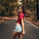 women, t-shirt, jeans shorts, road, hair in face, trees, outdoors, forest wallpaper