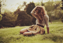 women outdoors, skirt, sitting, grass, hands in hair, depth of field wallpaper